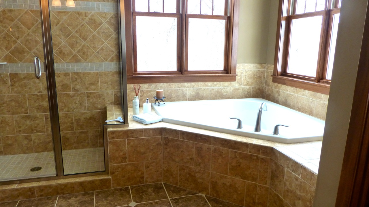 master bathroom with corner tub
